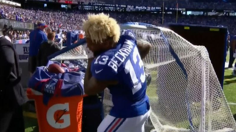 New York Giants receiver Odell Beckham Jr. loses a battle with a kicking net on the Giants' sideline. (Screenshot: NFL Network)