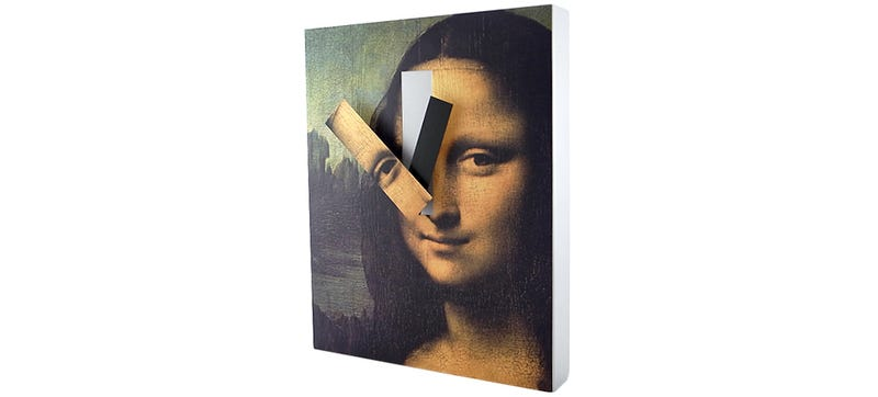 Illustration for article titled A Mona Lisa Wall Clock That Reconstructs the Masterpiece Over Time