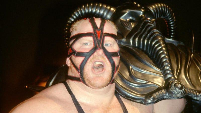 Big Van Vader carrying his amazing helmet.