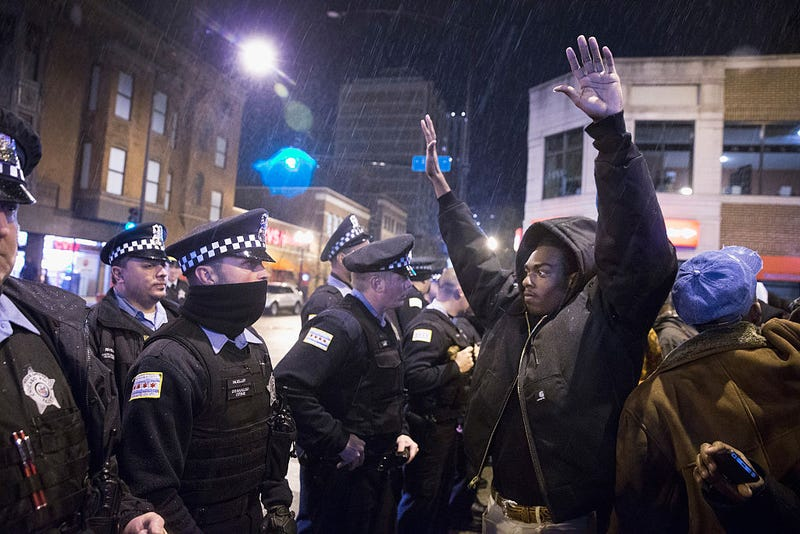 Demonstrators confront police during a protest over the death of Laquan McDonald on Nov. 25, 2015 in Chicago, Illinois (Scott Olson/Getty Images)