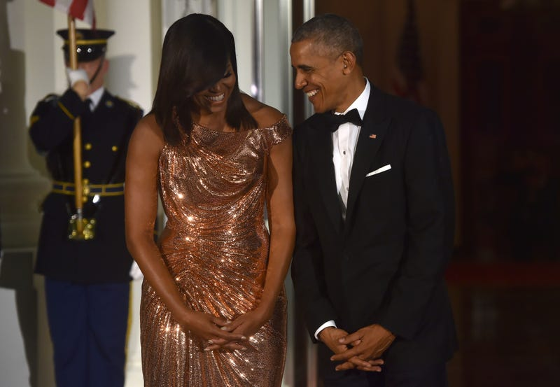 President Barack Obama and first lady Michelle Obama wait for the arrival of Italian Prime Minister Matteo Renzi and his wife, Agnese Landini, on the North Portico of the White House before a state dinner in Washington, D.C., on Oct. 18, 2016.NICHOLAS KAMM/AFP/Getty Images