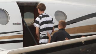Suspect Dylann Roof, 21, of Lexington, S.C., boards a plane at Shelby-Cleveland County Regional Airport in North Carolina on June 18 for extradition back to Charleston, S.C.Andy McMillan/Getty Images