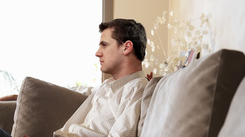 Man Desperately Trying To Wring Every Last Ounce Of Relaxation From Final Day Of Vacation