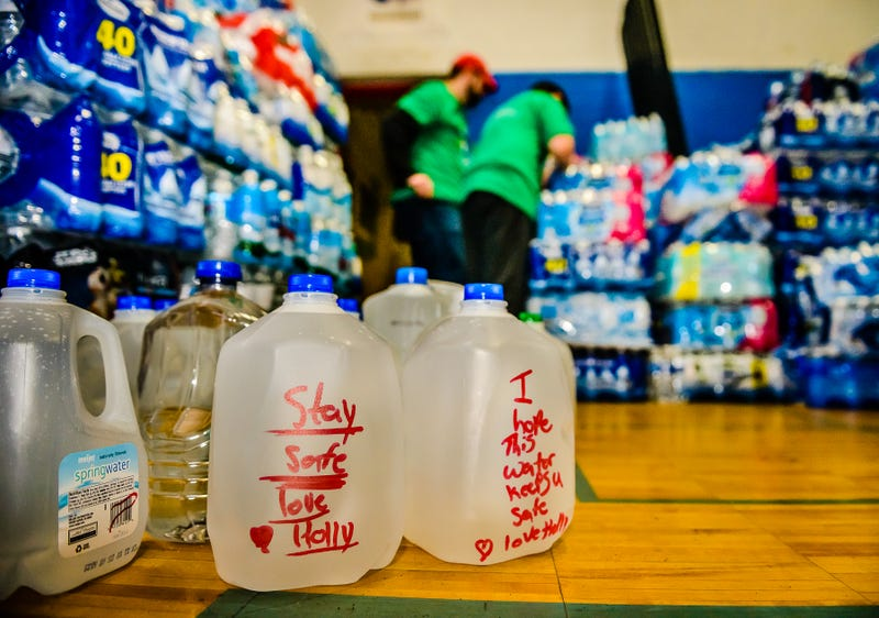 Some of the water distributed at the Comcast water collection event held Saturday, Feb. 20, 2016 at the Flint Boys and Girls Club in Flint, Mich. came with well-wishes from those that donated it.