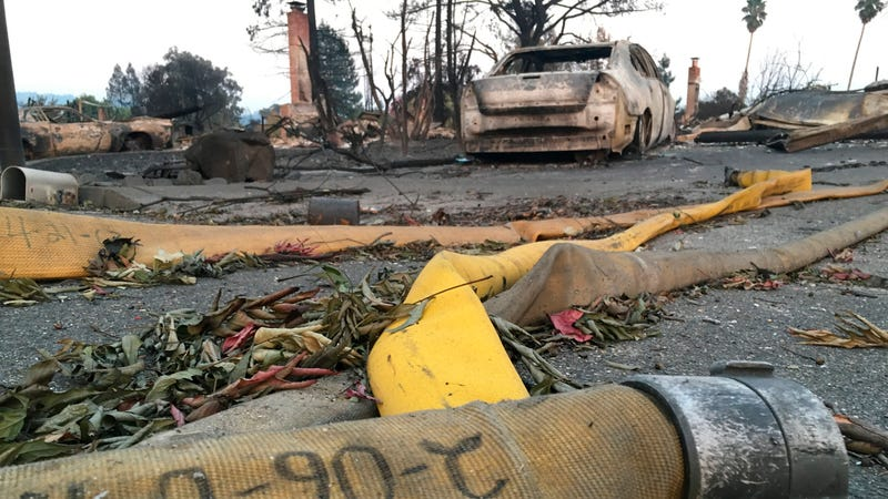 In this Friday, Oct. 13, 2017 photo, shows a fire hose abandoned in front of a living destroyed home the Coffey Park neighborhood of Santa Rosa, Calif. Image credit: Jonathan Copper/AP Images