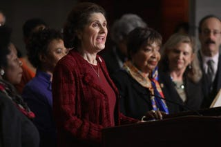 Lynda Johnson Robb, daughter of President Lyndon Johnson and wife of former Sen. Chuck Robb (D-Va.), is joined by Democratic members of the House of Representatives during an event marking the 50th anniversary of the start of the war on poverty at the U.S. Capitol Visitors Center, Jan. 8, 2014, in Washington, D.C.Chip Somodevilla/Getty Images