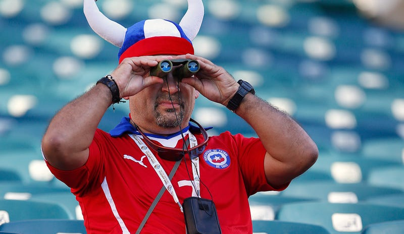 A Chile fan searches for competent defense; Photo via Getty