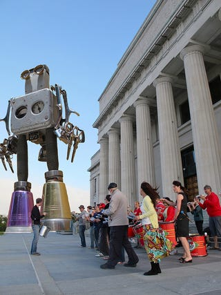Illustration for article titled Concept Art Writing Prompt: A Giant Robot Waits Outside a Museum
