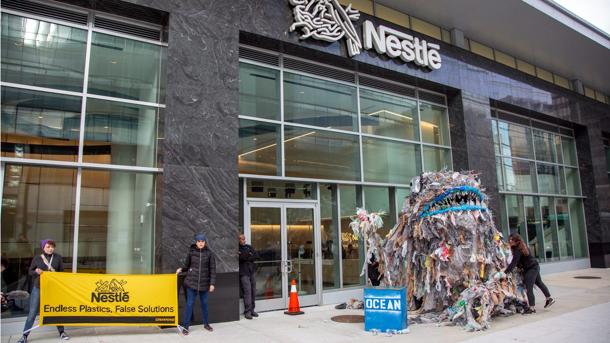 Activists Deliver Giant Trash Monsters to Nestlé Headquarters to