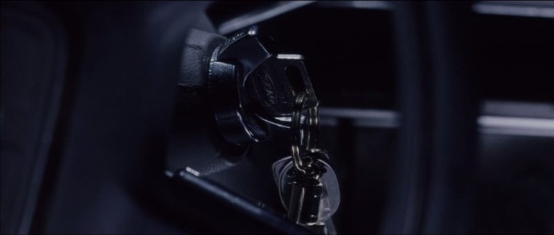 (1:35:41) From the back seat, Porter sees keys left in the ignition.