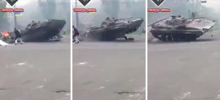 Illustration for article titled Ukrainian APC Driver Has No Time For Roadblock, Jumps It