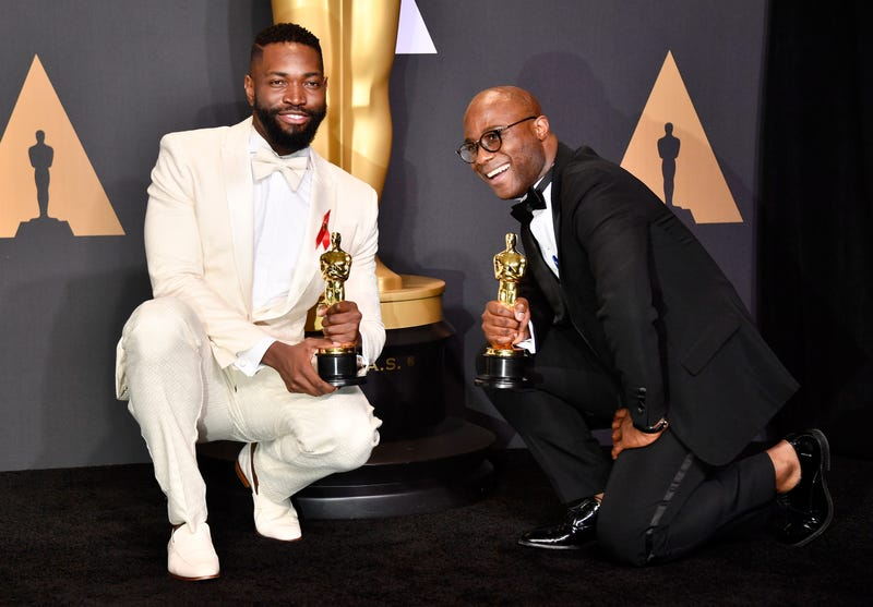 Screenwriter Tarell Alvin McCraney and writer-director Barry Jenkins, winners of Best Adapted Screenplay for Moonlight, pose in the pressroom during the 89th Annual Academy Awards at Hollywood & Highland Center on Feb. 26, 2017, in Hollywood, Calif.