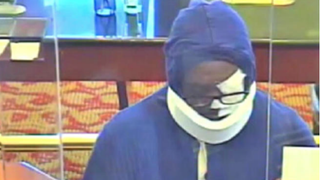 The FBI released this security-camera footage in hopes of catching a man who disguised himself in bandages to rob several Maryland banks.NBC Washington Screenshot