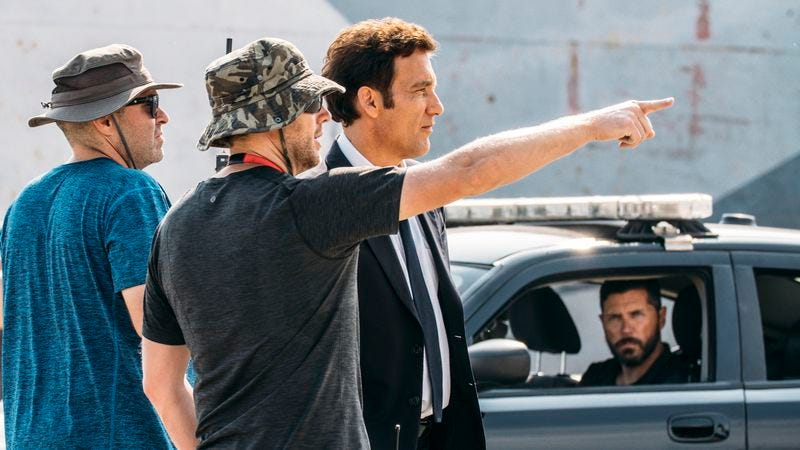 Neill Blompkamp (center) and Clive Owen (right) on the set of The Escape (Photo: BMW Films)