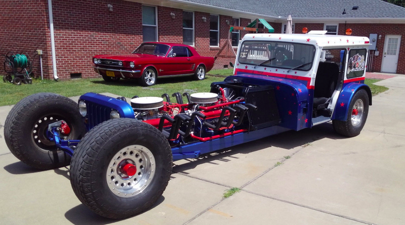 Someone's Selling a Postal Jeep Powered by Two Small-Block Chevy Motors Bolted Together