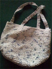 Illustration for article titled Crochet a Shoulder Tote from Grocery Bags