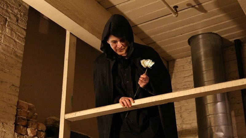 Illustration for article titled Life In Shadows: A Cloaked Merrick Garland Is Crouched In The SCOTUS Rafters Whispering A Dissenting Opinion And Clutching A Withered Rose