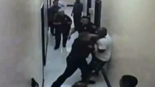 A screenshot of video footage showing Lonnie Jenkins being detained by police officers at the Renewal Halfway House in Pittsburgh in August 2014YouTube screenshot