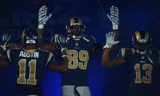 Tavon Austin, Jared Cook and Chris Givens of the St. Louis Rams pay homage to Michael Brown by holding their hands up during their pregame introduction against the Oakland Raiders at the Edward Jones Dome in St. Louis on Nov. 30, 2014.Dilip Vishwanat/Getty Images