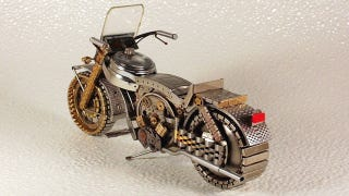 Illustration for article titled Many Watches Died to Make This Miniature Motorcycle
