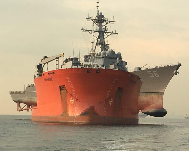 USS John S, McCain is carried aboard the heavy lift transport MV Treasure, Oct. 11, 2017. Treasure will transport John S. McCain to Fleet Activities Yokosuka, Japan for repairs.