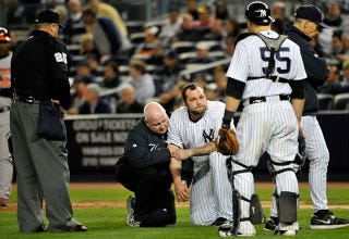 Illustration for article titled Joba Chamberlain Left Tonight's Game After Getting Nailed By A Flying Bat Shard