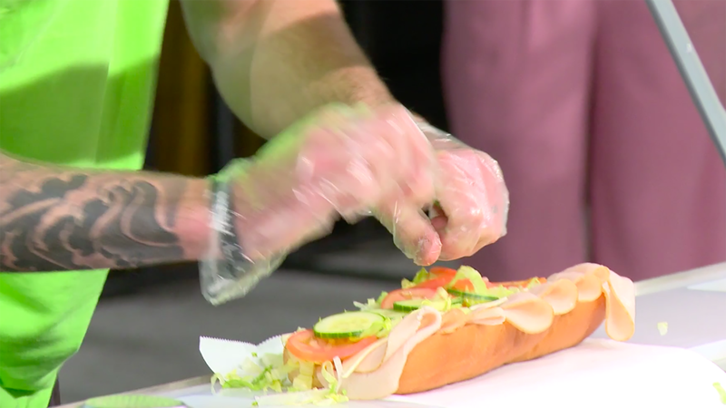 Illustration for article titled Subway's top sandwich artists engage in fevered hand-to-bread combat