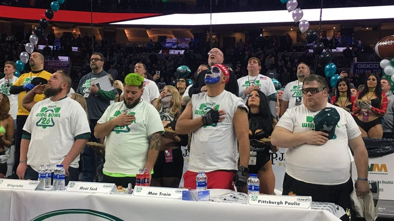 Wing Bowl competitors stand for the national anthem. Apparently Colin Kaeperwing didn't qualify. (Photo: Dan McQuade/Deadspin)