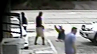 Screenshot from surveillance video showing Michael Drejka raising his gun to shoot Markeis McGlockton, an unarmed black man, at a Florida convenience store. The dispute began about a parking space.