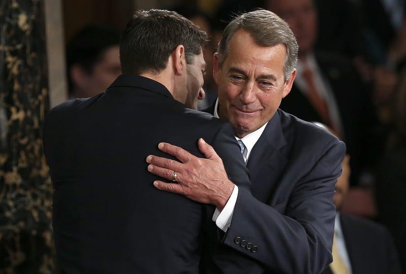 Former House Speaker John Boehner hugs his replacement Paul Ryan, in 2015.