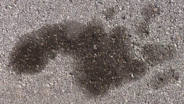 Use cola to clean up oil stains for Getting stains off concrete