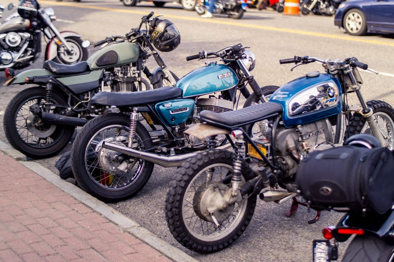 My hunk of junk kz750 twin (olive green) next to a couple of builds from a&j cycle