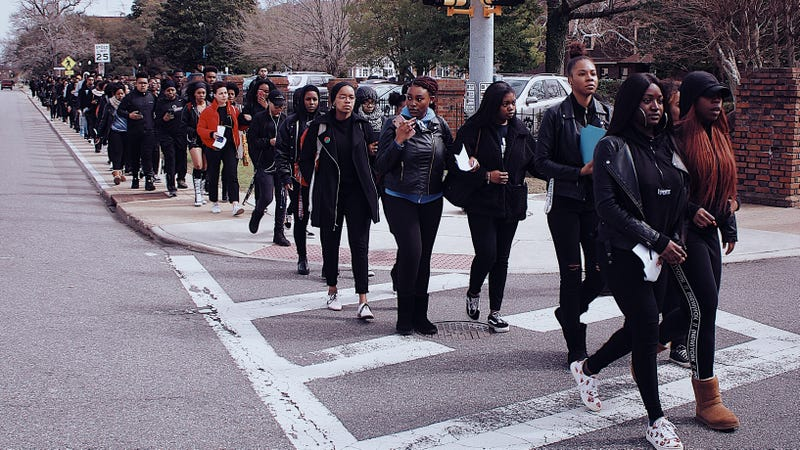 Students at Hampton University march to protest sexual assault and campus conditions.