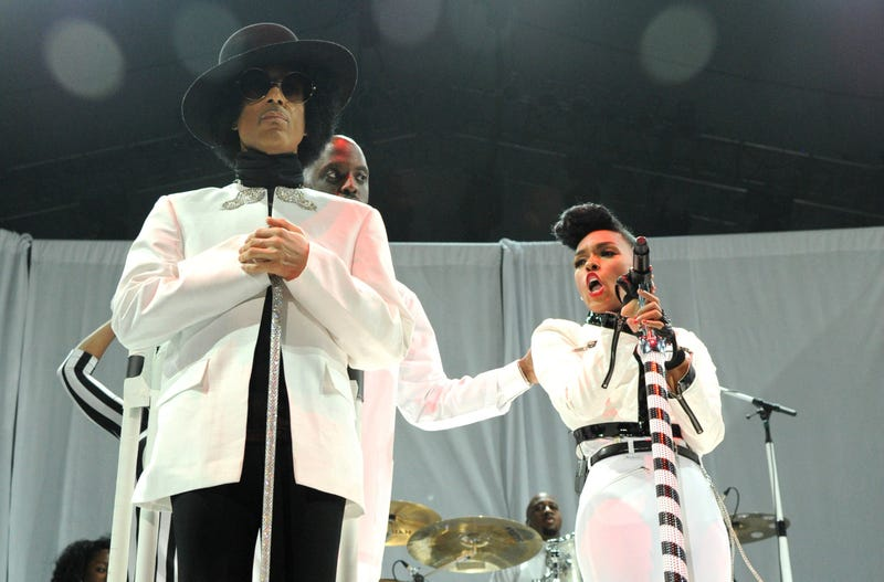 Janelle Monáe performs with Prince at the Mohegan Sun Arena in December 2013