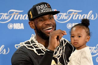 LeBron James of the Cleveland Cavaliers holds his daughter Zhuri during a press conference following the Cavs' defeat of the Golden State Warriors 93-89 in Game 7 to win the 2016 NBA Finals June 19, 2016, in Oakland, Calif.Thearon W. Henderson/Getty Images