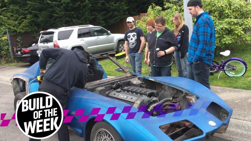 You can't help but stare at a Corvette full of BMW parts getting its top sawzalled off.