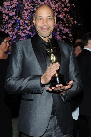John Ridley, winner of Best Adapted Screenplay for 12 Years a Slave, attends the Governor's Ball after the 86th Academy Awards on March 2, 2014, in Hollywood, Calif. VALERIE MACON/Getty Images