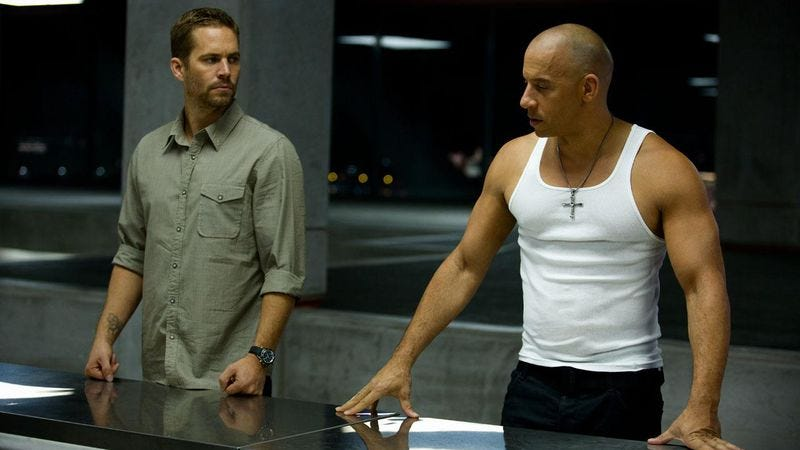 Illustration for article titled Caption Contest: What are the brainiacs from Fast & Furious 6 talking about?