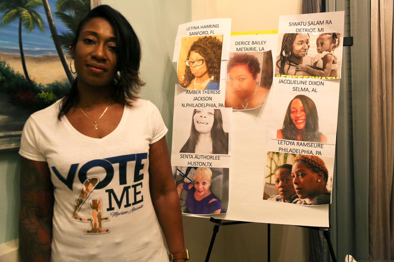 Marissa Alexander standing in her Jacksonville, Fla., home next to a board of women who were victims of domestic abuse, on October 24, 2018.