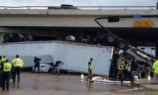 Illustration for article titled Semi Falls Off Overpass Onto Camry in Texas, Everybody Walks Away Unscathed