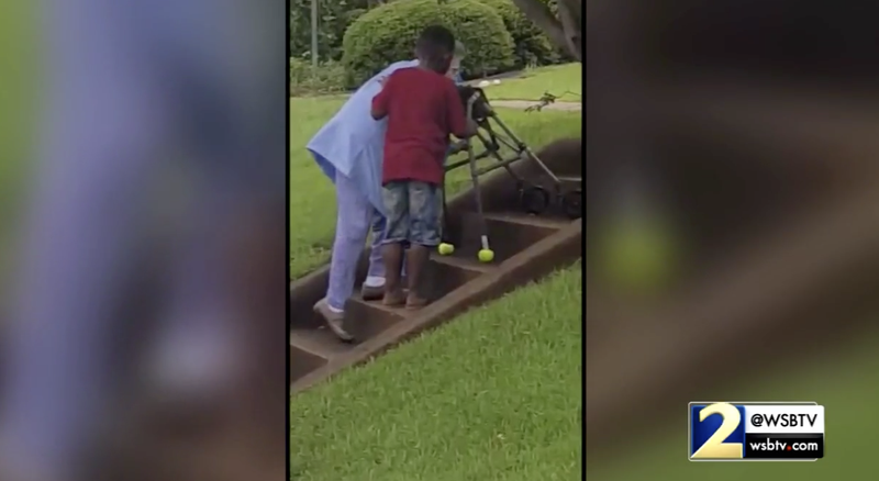 Illustration for article titled This Video of a Georgia Boy Helping an Elderly Woman Up the Stairs Is the Feel-Good News We All Deserve to See