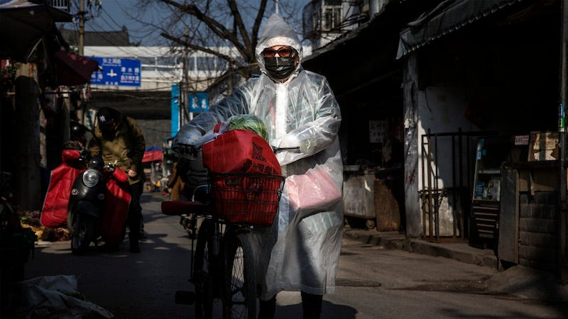 A woman in Wuhan, the provincial capital where the virus was first detected, goes out on Feb. 9.