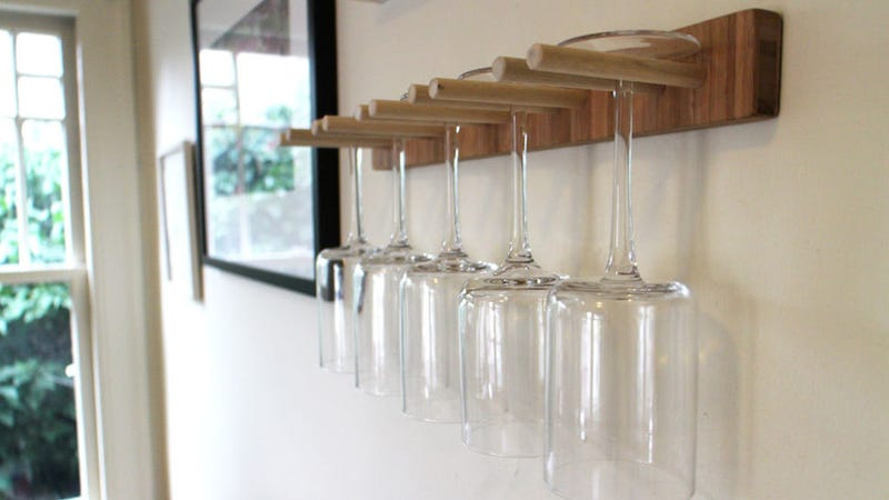 If you're looking for a place to keep your wine glasses that doesn't take  up space in your cabinets, this DIY wine glass rack was made from scrap  wood, ...