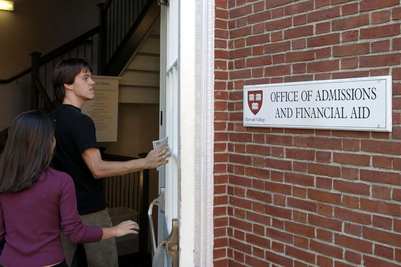 Students enter the Admissions Building on the campus of Harvard University on Sept. 12, 2006, in Cambridge, Mass. (Glen Cooper/Getty Images)