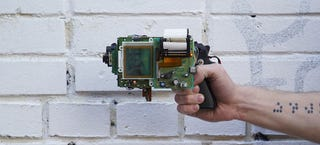 Illustration for article titled Guy invents an 8-Bit instant camera gun that prints images on receipts
