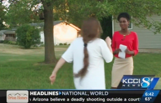 Reporter Emmy Victor stayed calm June 28, 2016, in Boone, Iowa, as a woman, identified later by police as the mother of a man police shot, shouted racial slurs.KCCI screenshot