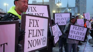 Demonstrators demand action from the Republican presidential candidates about the water crisis in Flint, Mich., outside the historic Fox Theater before the GOP presidential debate March 3, 2016, in Detroit.Chip Somodevilla/Getty Images