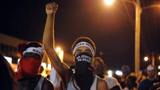 Protesters take part in a peaceful protest along a street in Ferguson, Mo., on Aug. 19, 2014. Michael B. Thomas/AFP/Getty Images