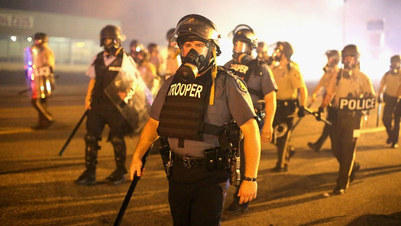 August 17, 2014: Cops surrounded by tear gas during the Ferguson protests