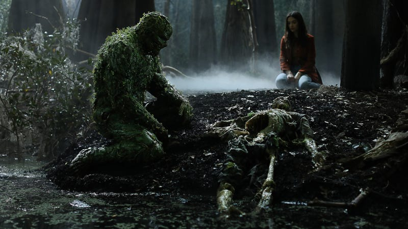 Swamp Thing and Abby Arcane staring at Alec Holland's skeleton.